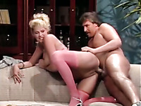 Chubby blonde MILF in milk stockings blows and gets busted