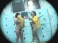 Spy cam clip with two gals drying their bodies in public shower