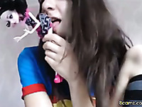 hot teen fucks herself with a doll and loves playing around