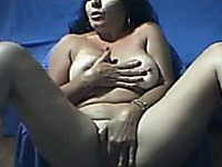 Slutty mature woman masturbates for me in front of her webcam