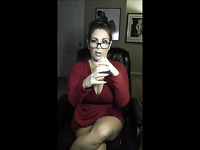 Lovely looking sexy MILF in glasses is ready to flash her gorgeous boobies