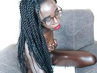 Black cam girl spanks her asshole with black dildo