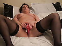Mature wife masturbates with a dildo on private sex video