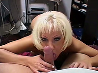 Feisty blonde wench with big boobs gives stout blowjob in the office