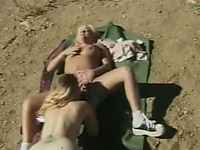 Lesbian show by two gorgeous blonde slut on the rocks outdoors