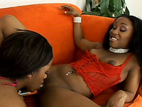 Two black lesbians toying and licking each others slits