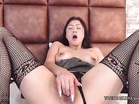 Stocking asain girl is fingering her pussy