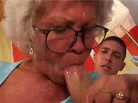 Horny granny pokes her hairy pussy with big pink dildo